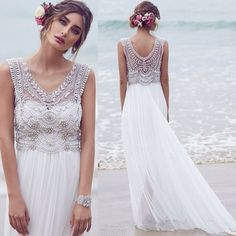 Wedding dress with lace and bead detail on bodice.