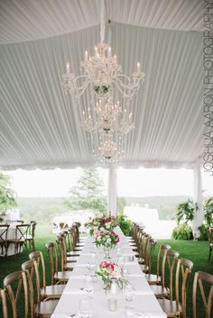 hanging chandelier over an estate wedding table with crossback chairs