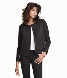 Black. Short, straight-cut jacket in textured woven fabric. Pleat at back, rounded neckline, and concealed fasteners and patch pockets at front. Lined.