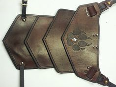 Sentinel segmented leather shoulder armor with graphic
