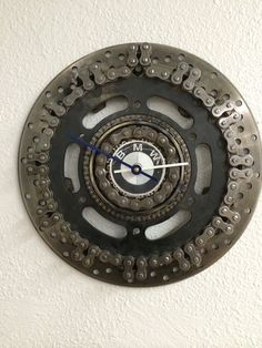Recycled motorcycle parts clock on Etsy, $125.00