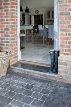 Slight step up into family room?Ballanstone Tumbled Limestone, cobbles and flagstone for outdoors. Mandarin Stone.
