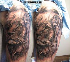 (*u*)/ Lion Tattoo on arm