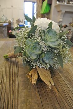 Bridal bouquet with succulents, hydrangea, baby's breath, seeded eucalyptus.
