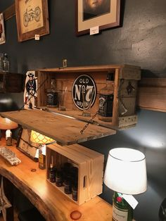 This is a military ammo box I converted into a wall bar/display bar. I attached a cleat on the back to attach it firmly to the wall. I added the Ole #7 sign and the chain to hold the lid/shelf level. Check out our Facebook page at Lynthia Designs & Country Chic Weddings.