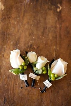 White rose boutonnieres from Vanda Floral Design | photography by http://volatilephoto.com/