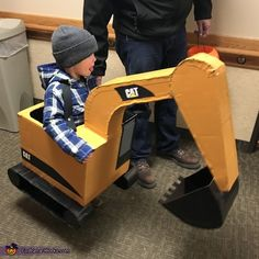 My 3 year old son is wearing the excavator costume. My husband spent about 8 hours using cardboard, hot glue, gorilla tape, spray paint, and stickers to bring my idea to life. Halloween Costume Contest, Halloween 2020, Costume Ideas, Gorilla Tape, Monthly Pictures, Costume Works, Son Love, Boy Costumes, Picture Ideas