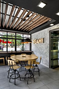 <img> The new architectural concept for Goody's Burger House restaurants was created by Chadios+Associates in response to the company's desire to redefine the identity of its fast food venues that have e… - Burger Restaurant, House Restaurant, Restaurant Design, Cafe Interior Design, Cafe Design, Lamp Inspiration, Coffee Shop Design, Modern Architecture House, Decoration