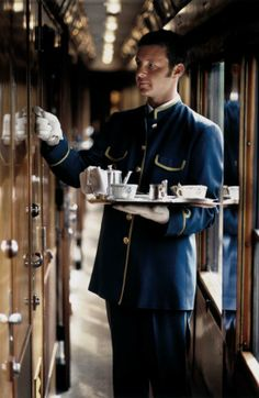 Staff Steward Corridor Afternoon Tea Venice Simplon-Orient-Express Europe train.