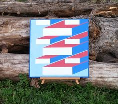 Original design called Blue Sky and Fresh Cut Lumber.  This design was inspired by our sawmill business and how we the lumber looks once it is cut and stacked.  This is made from MDO plywood that has routered edges and is painted with 4+ coats of exterior paint. This is 2 foot square.