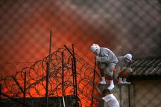 Guatemala City, Guatemala  Inmates try to escape from a juvenile correctional facility during a riot in which seven staff members were taken hostage and beaten Photograph: Esteban Biba/EPA