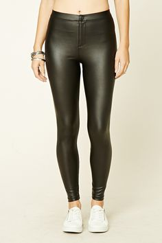 SIZE LARGE    Style Deals - A pair of faux leather leggings featuring an elasticized waist and a zip fly with hook-eye closure.