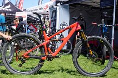 Spot Brand Mayhem 29er trail mountain bike with Living Link carbon fiber leaf spring suspension