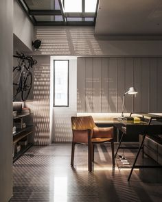 Great use of built-in shelving, lighting and textural material