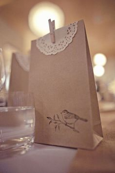 Brown paper gift bag, stamped and a doily added.  Love the simplicity