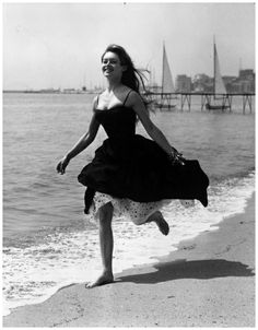 Running barefoot on the sands at Cannes, French film star, Brigitte Bardot