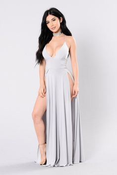 - Available In Black And Silver - V Neckline - Open Back - Thigh High Slits - Maxi - 96% Polyester, 4% Spandex