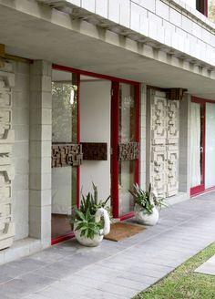 Wall imprints on house exterior, taken from design of Singer sewing machine casings. Perth home of Renee Coleman. Designed and built by Iwan Iwanoff, 1960s. Via the Design Files.