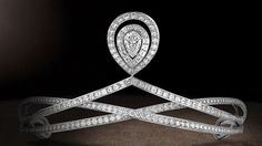 Platinum tiara set with a five carat central pear-cut diamond of D-flawless quality, entirely paved with brilliant-cut and baguette-cut diamonds. The tiara is transformable; the central motif can be detached and attached to the necklace as a pendant. Chaumet, Paris