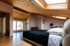 The perfect place for sweet dreams.   #bedroom #attic #windows #wood #Marche