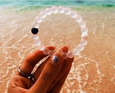 Such a cool message behind these bracelets. Injected in the black bead is mud from the Dead Sea. In the white beads are water from the top of Mount Everest. The highest and lowest points on earth. So whether you're feeling on top of the world or down on your luck, these Lokai bracelets remind you to stay humble, hopeful and to keep moving forward. Lokai bracelets!!! Only $18 per bracelet, and 10% of that goes to charity.