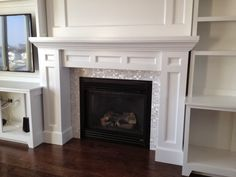 DIY built-in fireplace surround - MOTHER OF PEARL TILES!
