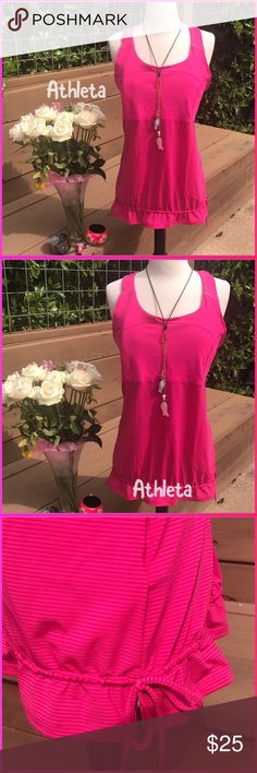 Athleta Infamous sorry wear, this hot pink Athleta top is on fire this summer. Work out to everyday, fabulous condition elastic waist cut out back. Just delicious!. Nylon/Lycra/spandex poly blend. Athleta Tops Tank Tops