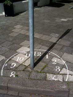 Sundial in Maastricht, Netherlands. I had this exact idea but someone beat me to it. Would be interesting to create street art installations using shadows though. You could use traffic signs and other urban objects to create fun art. New York Graffiti, Street Art Graffiti, Graffiti Artists, Land Art, Urbane Kunst, Funny Drawings, Sundial, Wow Art, Chalk Art