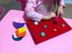 button board to work on gross motor and buttoning!! cute can also be used as a geo board with a shoe lace!