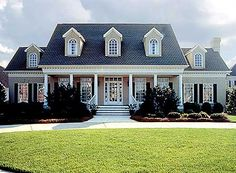 Southern colonial. Beautiful use of windows by the home designer.