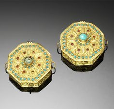 Persia | Two Qajar turquoise set gold amulet cases | 19th century | 6'600£ ~ sold (Oct '09)