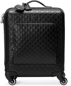Gucci Signature carry-on. A compact four wheel carry-on made in heat debossed Gucci Signature leather with a defined print and firm texture. Black Gucci Signature leather with black leather details Palladium-toned hardware Four 360° wheels. #suitcase#ad