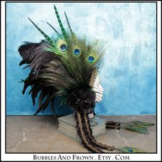 Eye Of The Peacock.... Feather Headband with Green and Black. $176.66, via Etsy.