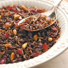 2 steps to make this wild rice with cranberries, pine nuts, onion, garlic, and thyme.
