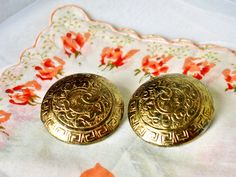 Gold Tone Ornate Medallion Clip On Earrings by dazzledbyvintage on Etsy