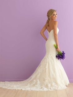 Striking yet subtle, this fit-and-flare strapless gown features a gorgeous train and scalloped edging.