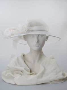 Bouquet | Label: Stephen Jones | Spring/Summer 2014, Carte Blanche Collection | Ivory net wide-brimmed hat  with wavy brim and silk flower, nylon spotted tulle and bow trim. Summer wear | Made in England