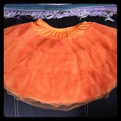 Orange tulle pedi coat. Cute with costumes for Halloween. Never worn. One size fits most Dresses