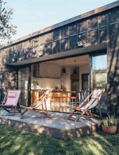 High-quality materials shine out in simple furnishings that have a penchant for the raw and natural in this Hawke's Bay Airbnb amidst an olive grove. Little Cottages, House Tours, Middle, House Design, Patio, Small Houses, Space, Outdoor Decor, Home