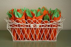 Creative Easter Party Decoration Idea with Orange Frabrics with Green Spoons and Forks in the white Basket -