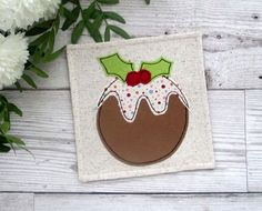 A figgy pudding coaster, a fun way to add some festive cheer to your coffee table or desk at work! The coaster has been appliqued in cotton fabric using free motion machine embroidery which allows me to draw freehand with the needle and thread on. Retro Christmas, Rustic Christmas, Handmade Christmas, Christmas Gifts, Christmas Gift Decorations, Christmas Themes, Free Motion Embroidery, Machine Embroidery, Figgy Pudding