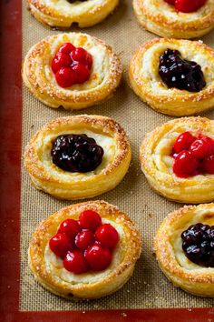 Cream cheese danish topped with cherry and blueberry pie filling.