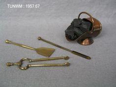 https://flic.kr/p/Bce2v5   Doll's house coal scuttle and fireside tools, about 1840   Coal scuttle and fireside tools from Rigg Doll's House, about 1840.  On display at Tunbridge Wells Museum & Art Gallery.