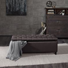 This modern storage ottoman accentuated with button tufting provides ample storage and features an elegant dark grey colored soft fabric with black legs.