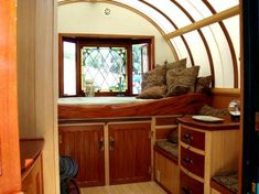 Interior of the gypsy caravan with the stained glass window