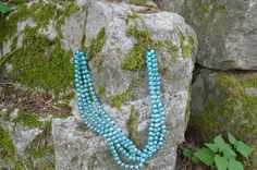 light blue beaded necklace.
