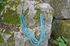 light blue beaded necklace.