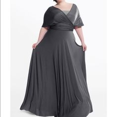 Henkaa dark gray convertible dress This Henkaa dark gray convertible dress is a plus size (14-24). They only come in standard size 0-14 then plus 14-24. I have only worn the dress one time. In great condition! The dress has been altered to fit someone that is 5'6 1/2 that is wearing flats! If you need to have it altered shorter it is very easy to be altered! The dress Is convertible and if you go to henkaa.com they shows you all the different ways it can be worn!! Make me an offer. Henkaa…