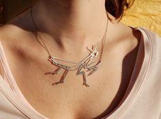 Praying mantis necklace. By megroberts on etsy.