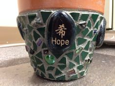 No one can have too many mosaic pots